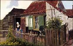 Künstler Ak Niederlande, Bauernhaus, Frau im Garten, Katze auf dem Holzzaun