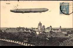 Ak Poznań Posen, Zeppelin über der Stadt, Starrluftschiff