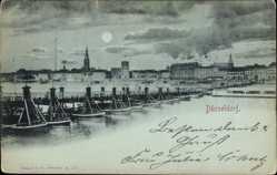 Mondschein Ak Düsseldorf am Rhein, Blick auf die Schiffsbrücke und den Ort