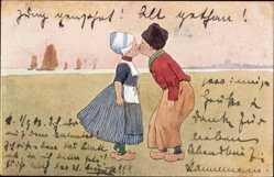 Künstler Ak Niederlande, Zwei Niederländer in Trachten küssen sich, BKWI 648 10