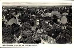 Postcard Lehrte, Stadtpanorama, Luftbild, Bäume, Häuser, Straßen, Turm