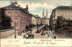 Postcard Magdeburg in Sachsen Anhalt, Wilhelmstraße mit Straßenbahnen
