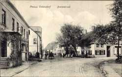 Postcard Preussisch Oldendorf, Blick in die Bremerstraße, Kutsche, Kinder