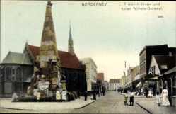 Postcard Norderney in Ostfriesland, Friedrichstraße und Kaiser Wilhelm Denkmal