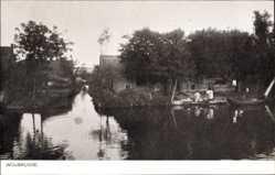 Postcard Woubrugge Südholland, Wasserpartie, Frauen am Ufer
