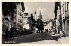 Postcard Kitzbühel Tirol Österreich, Straßenpartie, Autos, Geschäfte