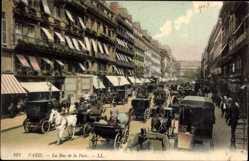 Ak Paris Frankreich, La Rue de la Paix, Kutschen, Geschäfte, Passanten