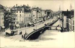 Postcard Zürich Stadt Schweiz, Partie am Limmatquai, Straßenbahn, Fluss, Brücke
