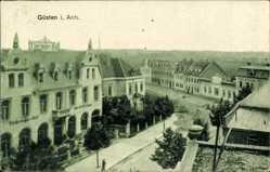 Postcard Güsten im Salzlandkreis, Thüringer Hof, Straßenpartie