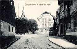 Postcard Schwanebeck, Partie am Markt, Fachwerkhaus, Turm, Kopfsteinpflaster
