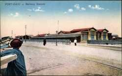 Postcard Port Said Ägypten, Railway Station, Bahnhof, Straßenseite, Passanten