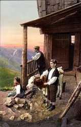 Ak Schweizer Familie in Trachten in die Ferne schauend