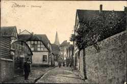 Postcard Lübbecke in Ostwestfalen, Steinweg, Mauer, Kirchturm, Fachwerkhaus