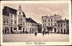 Ak Tuchola Tuchel Westpreußen, Marktplatz, Geschäfte, Johann Neumann