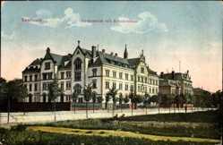 Postcard Saarlouis im Saarland, Straßenpartie mit Blick auf Gymnasium und Krankenhaus