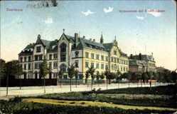 Postcard Saarlouis im Saarland, Blick auf das Gymnasium mit Krankenhaus, Straße