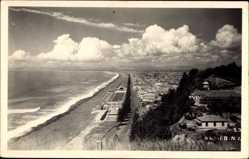 Foto Ak Napier Neuseeland, Blick auf die Stadt mit Strandansicht, Wolken