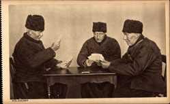 Ak Edam Volendam Nordholland, Niederländer spielen Karten am Tisch